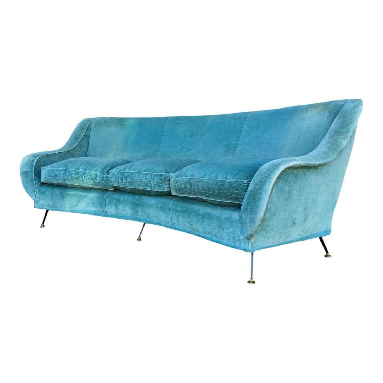 A 1950s Italian curved sofa with brass feet
