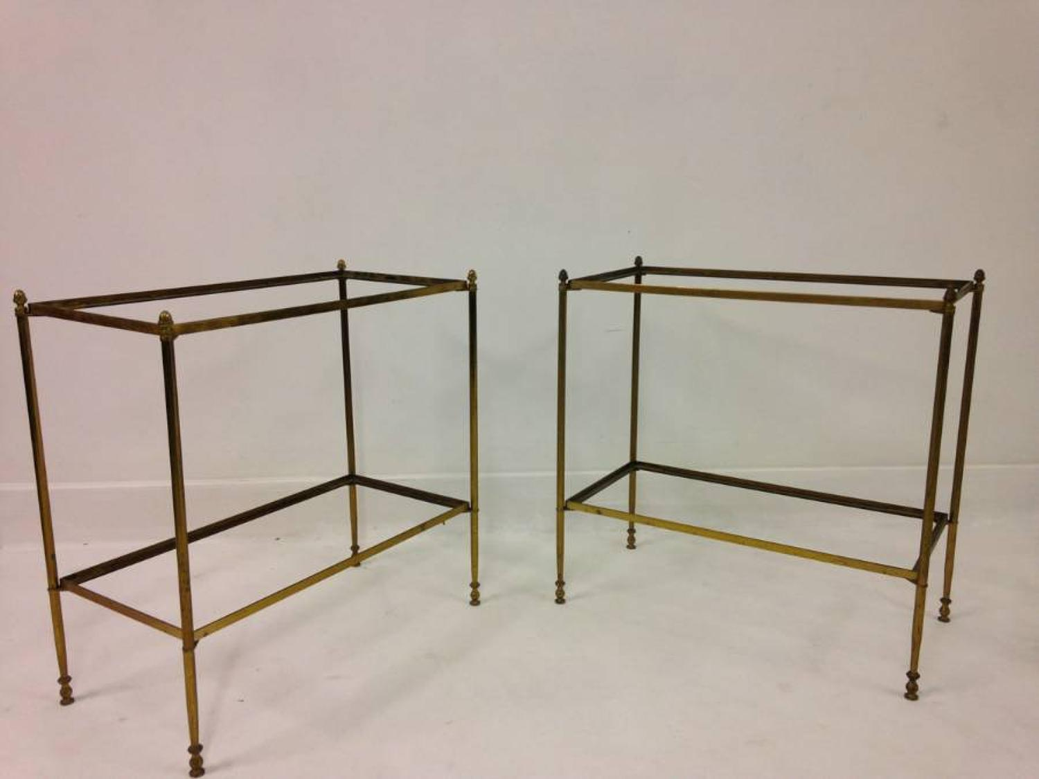 A pair of two tier brass side tables