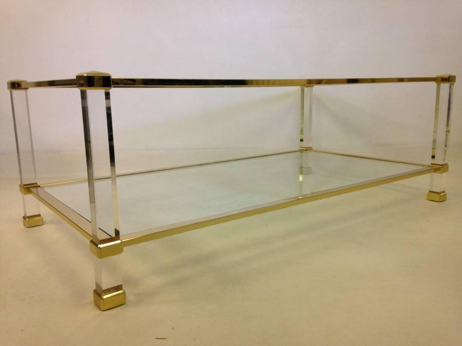 French lucite and brass coffee table