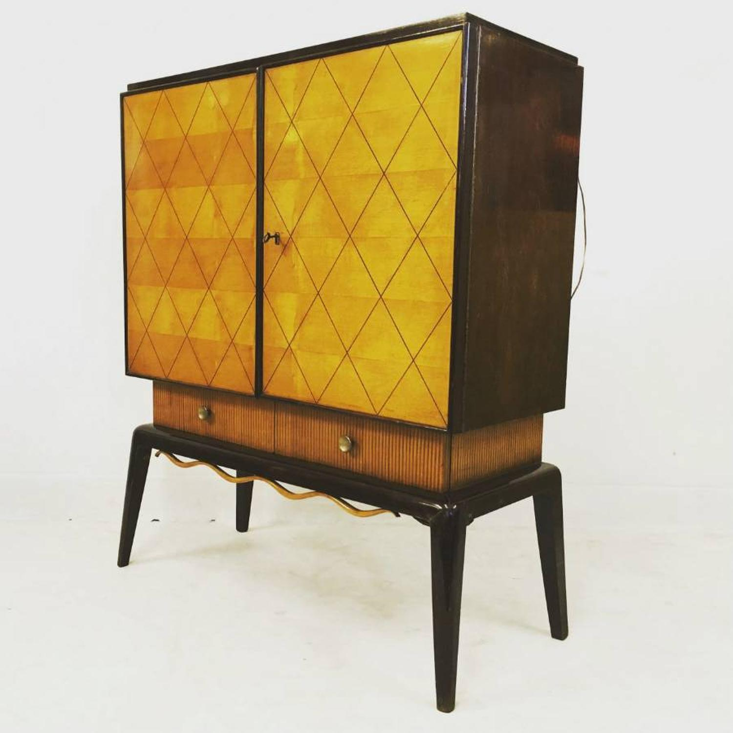 1950s bar cabinet with a moustache