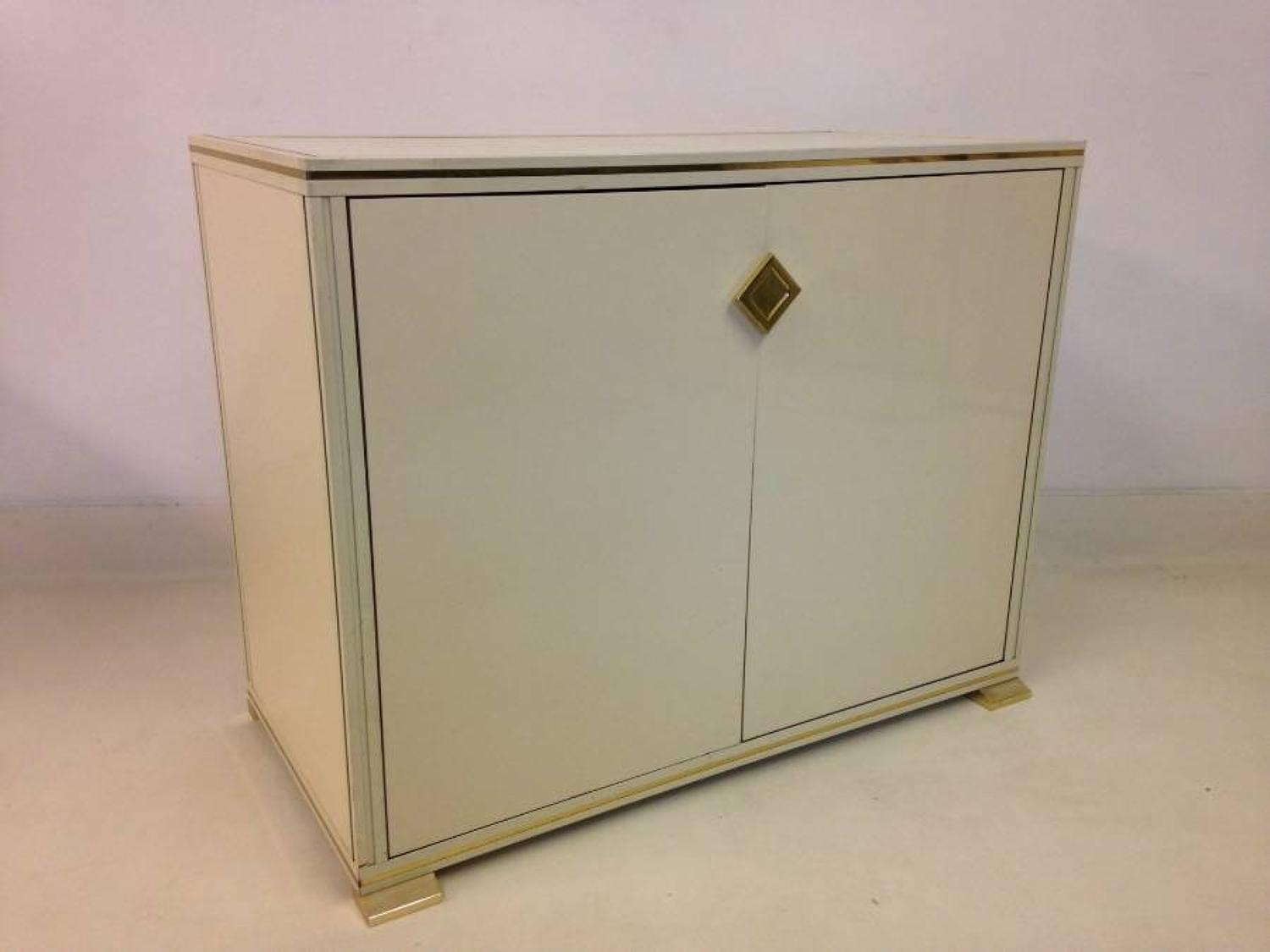 Lacquered wood and brass cabinet by Pierre Vandel