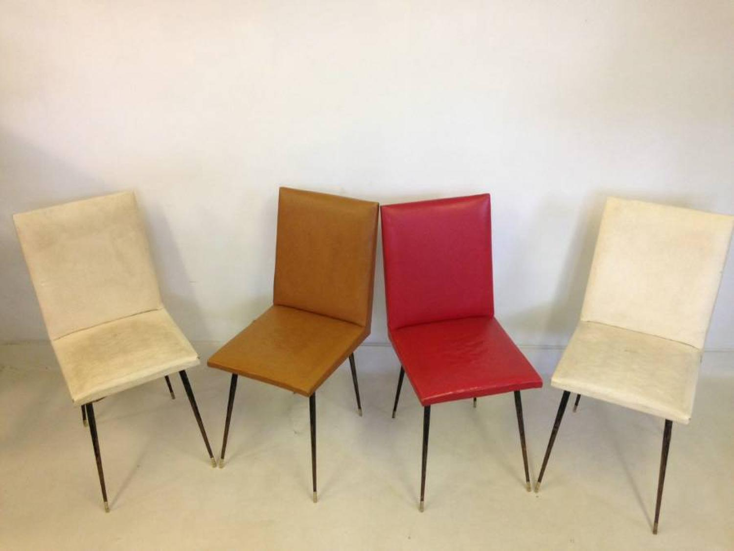 A set of four French steel and brass chairs
