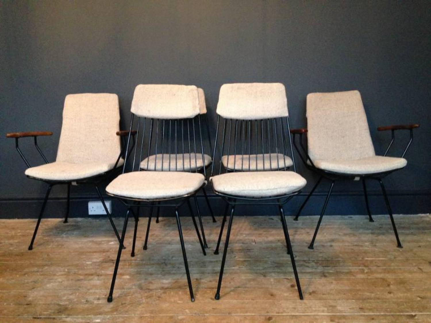 A set of six enamelled steel dining chairs
