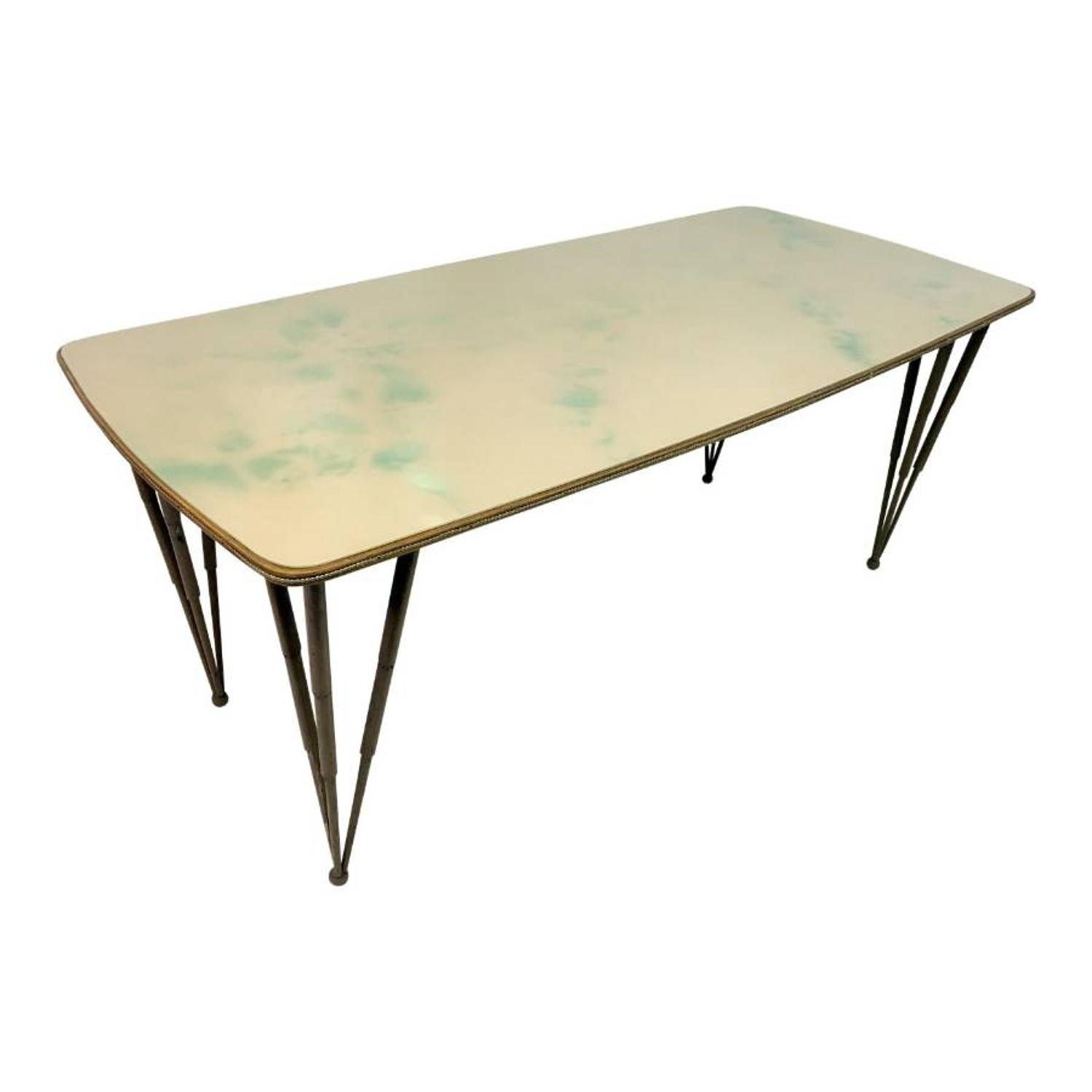 1950s Italian glass topped dining table with metal legs