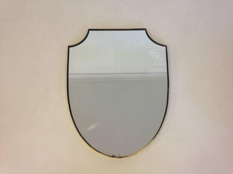 Brass framed shield mirror