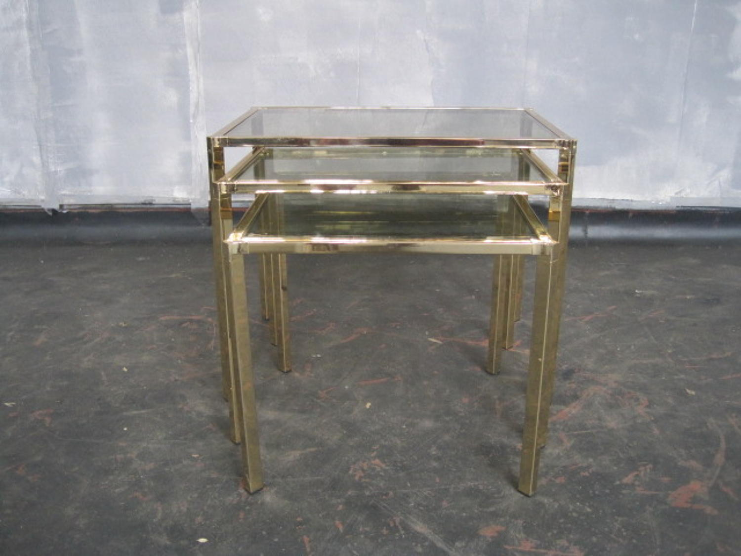 A 1970s brass nest of tables