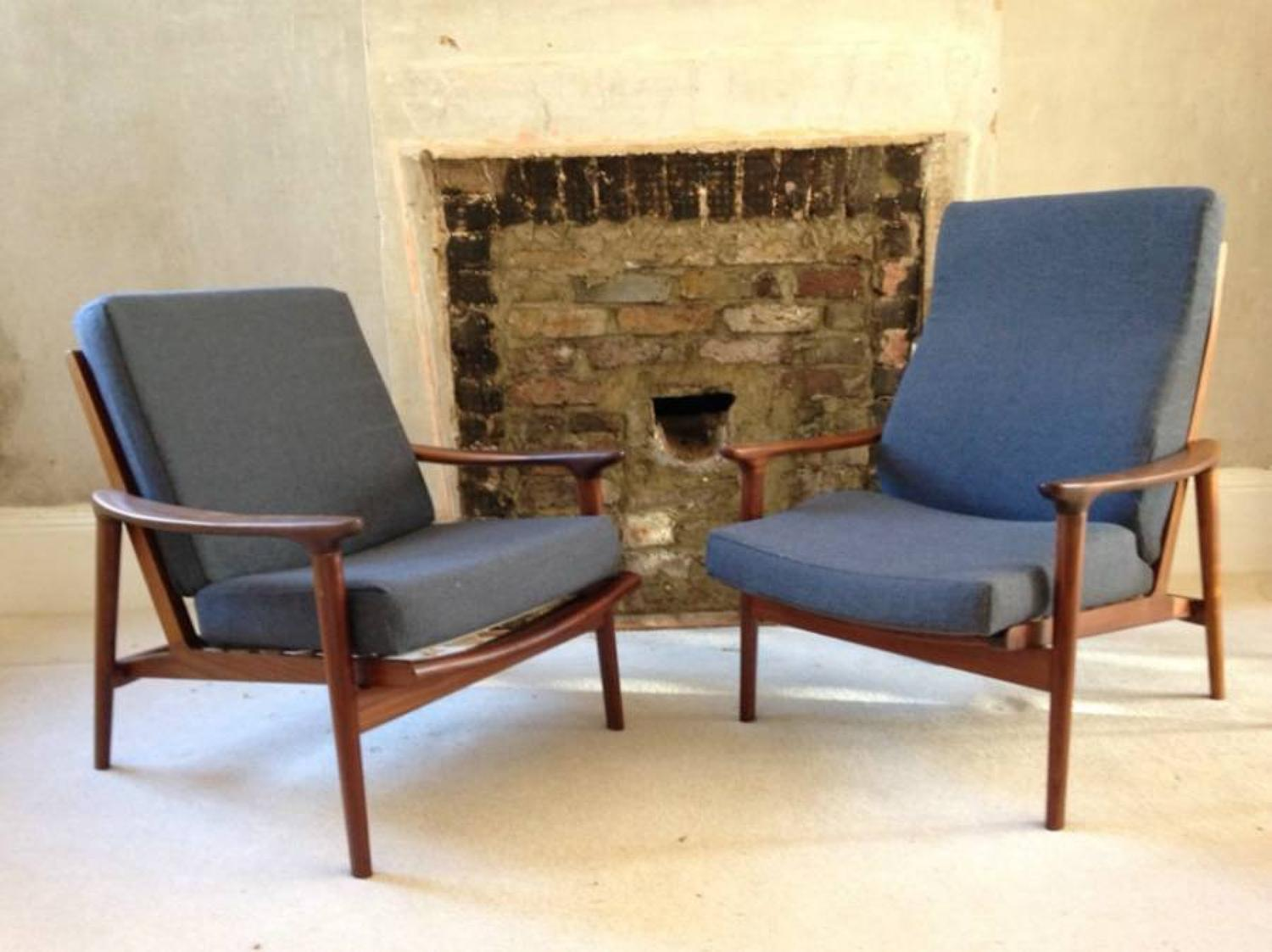 A pair of Guy Rogers armchairs