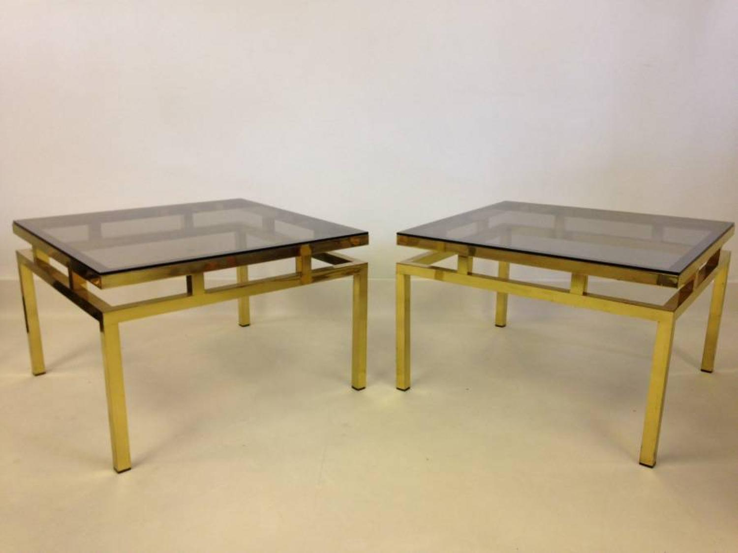 A pair of gilt brass tables
