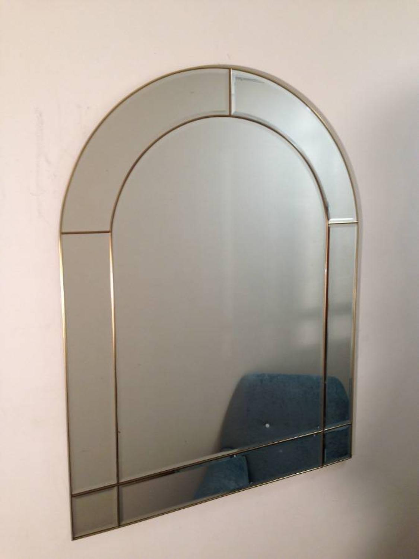 Arch shaped gilt metal mirror