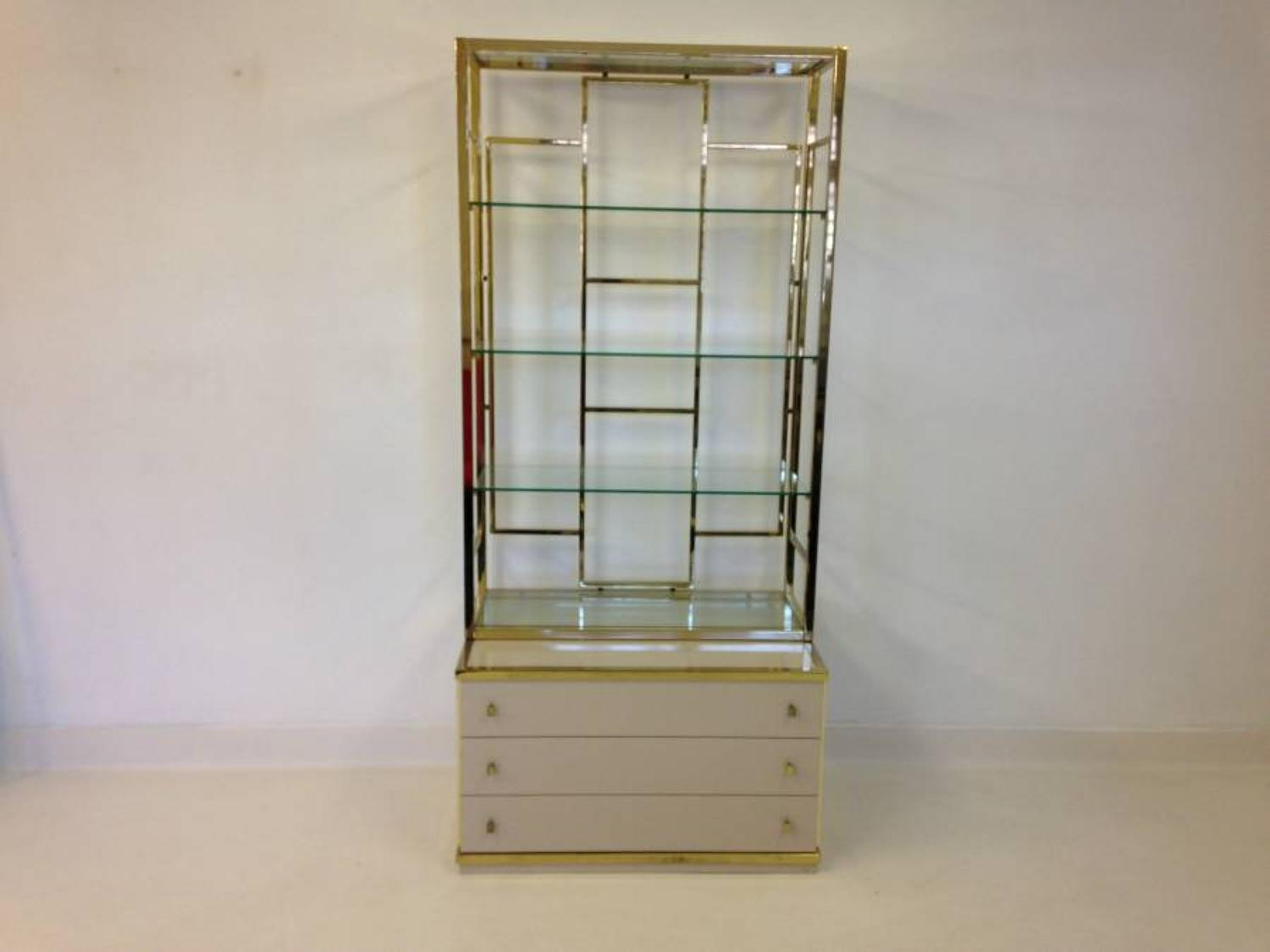 Brass and glass etagere on chest