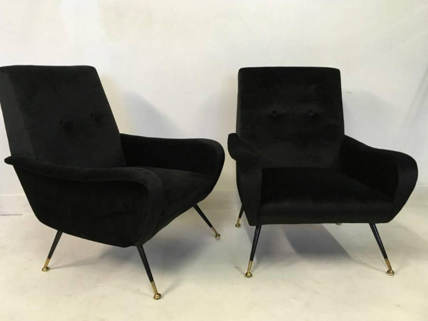 A pair of Italian armchairs in black