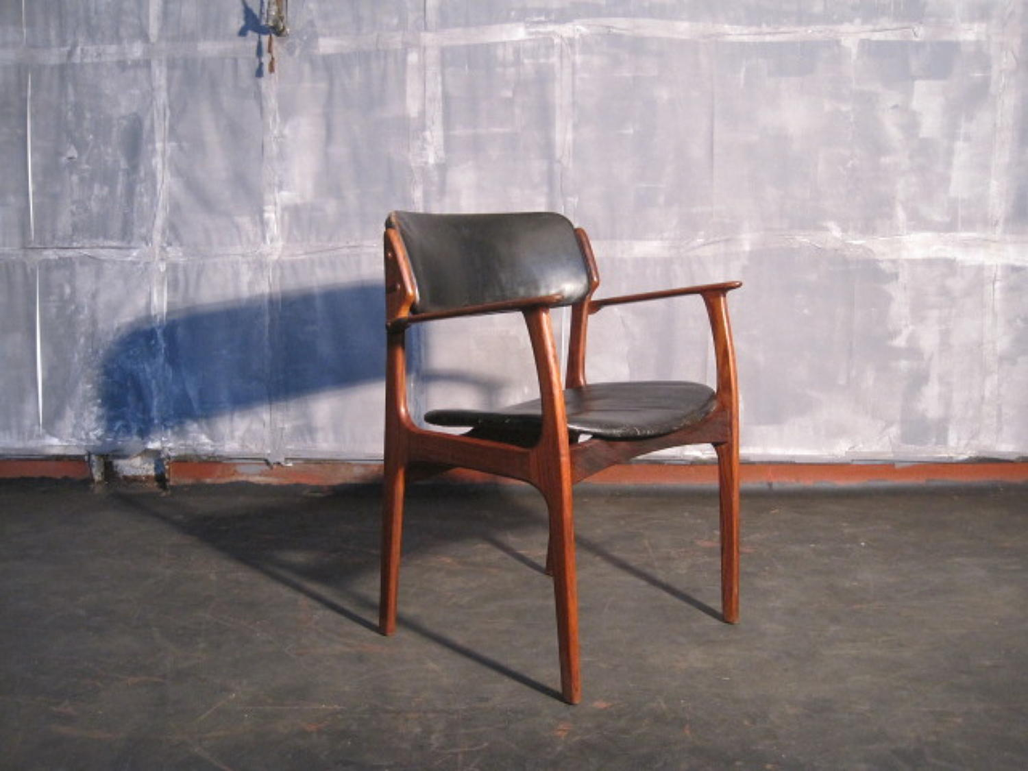 Rosewood and leather armchair by Erik Buck
