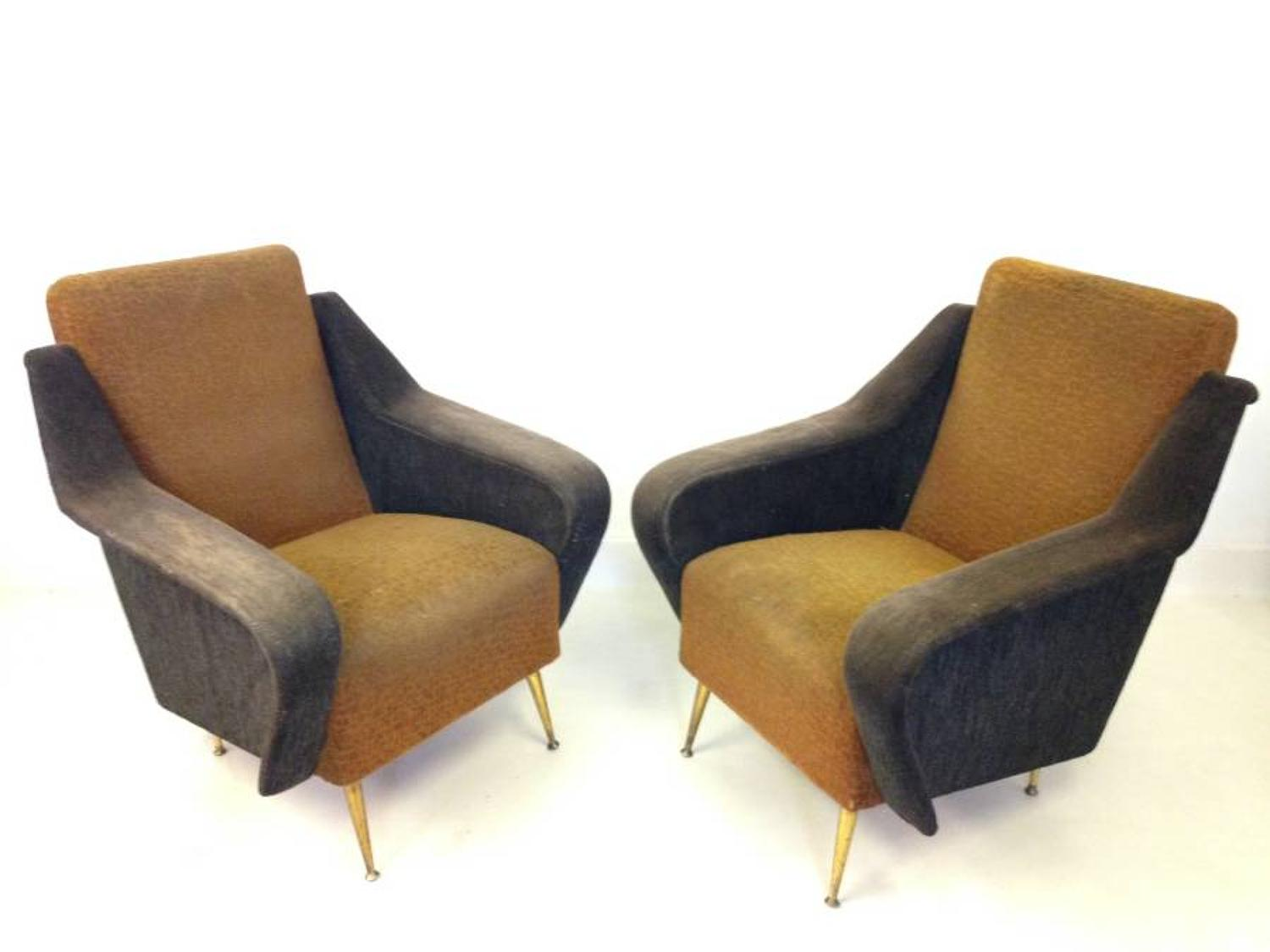 A pair of armchairs on brass legs
