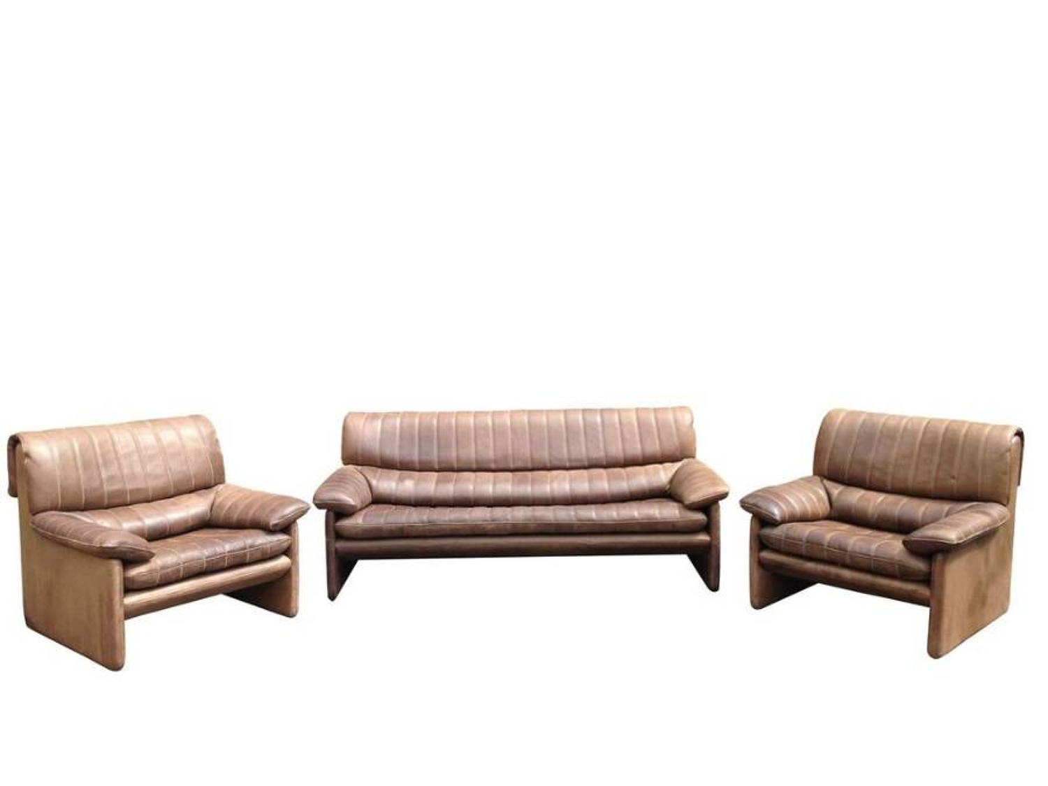 Leather sofa and two armchairs by De Sede