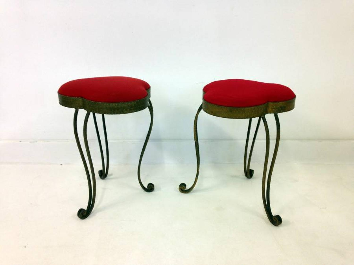 A pair of gilded wrought iron stools