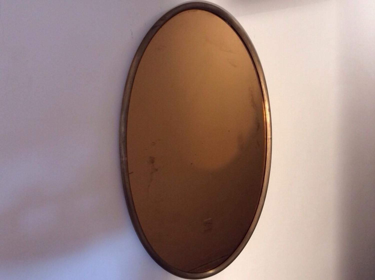 Metal framed mirror with brown smoked glass