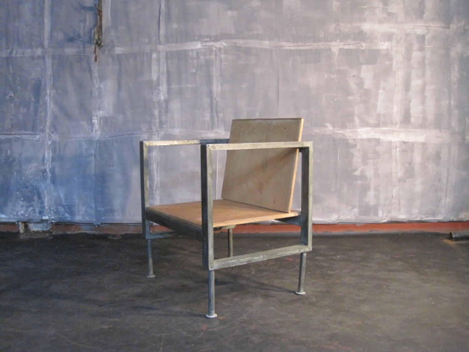 Industrial steel and plywood chair