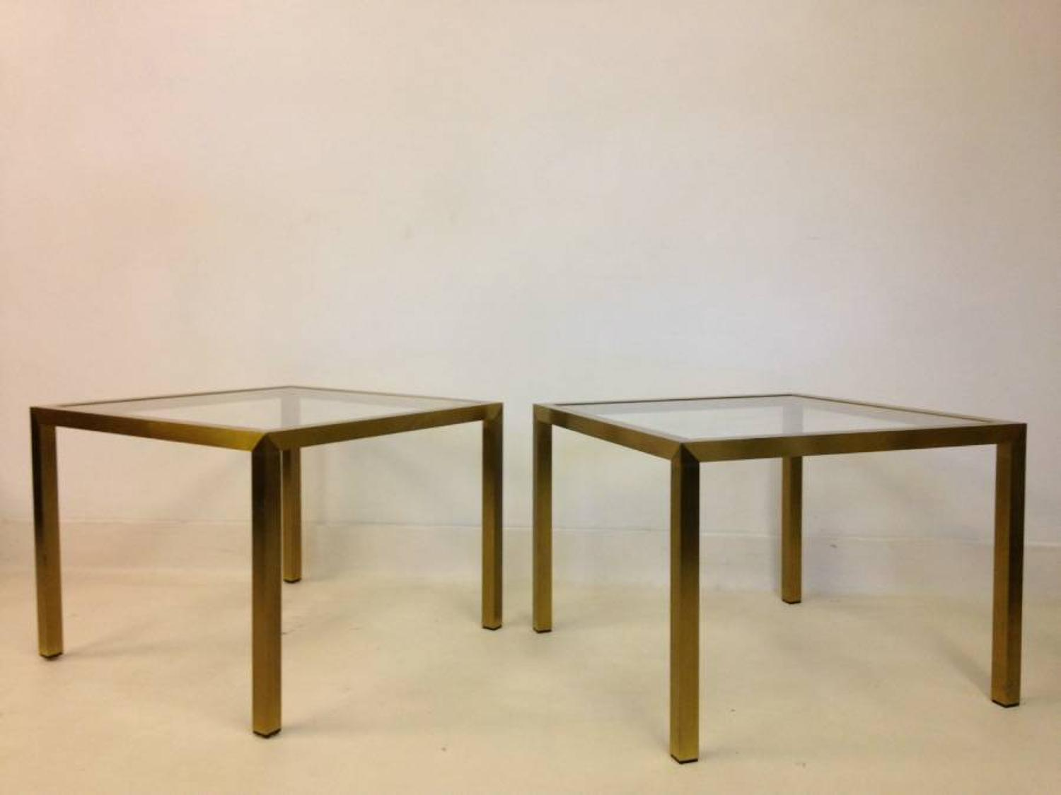 A pair of brushed brass side tables
