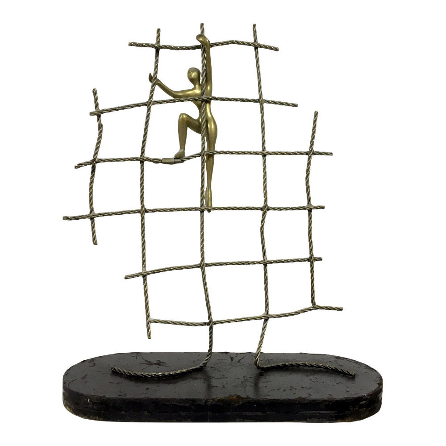 Abstract brass figure climbing up a net