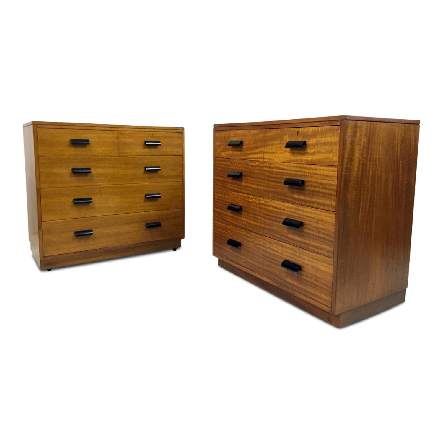 A pair of mid century teak chest of drawers