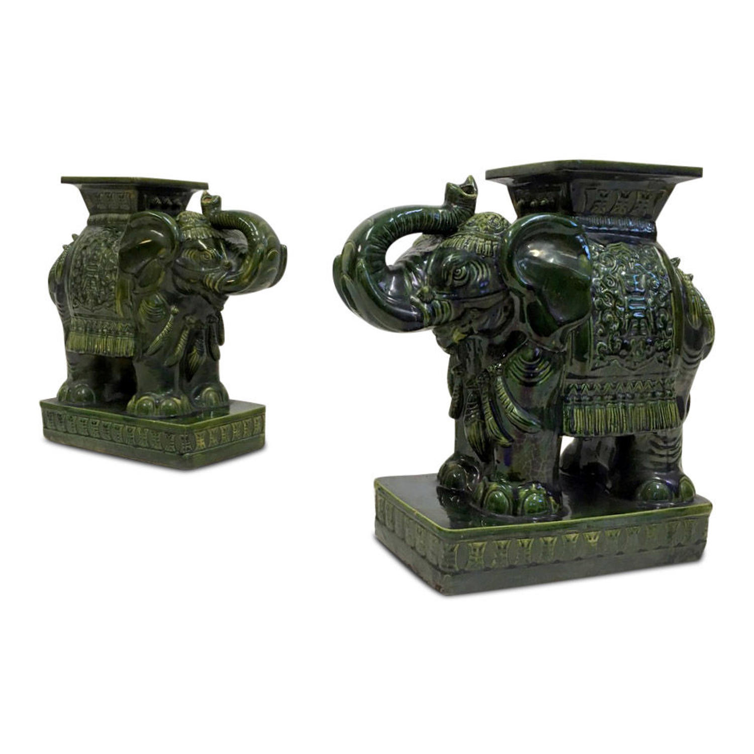 A pair of vintage green ceramic elephant stools or tables