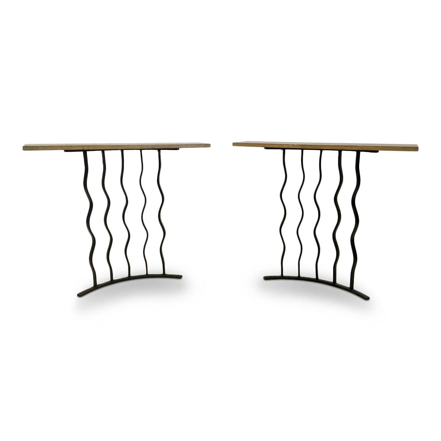 A pair of wrought iron console tables with oak tops
