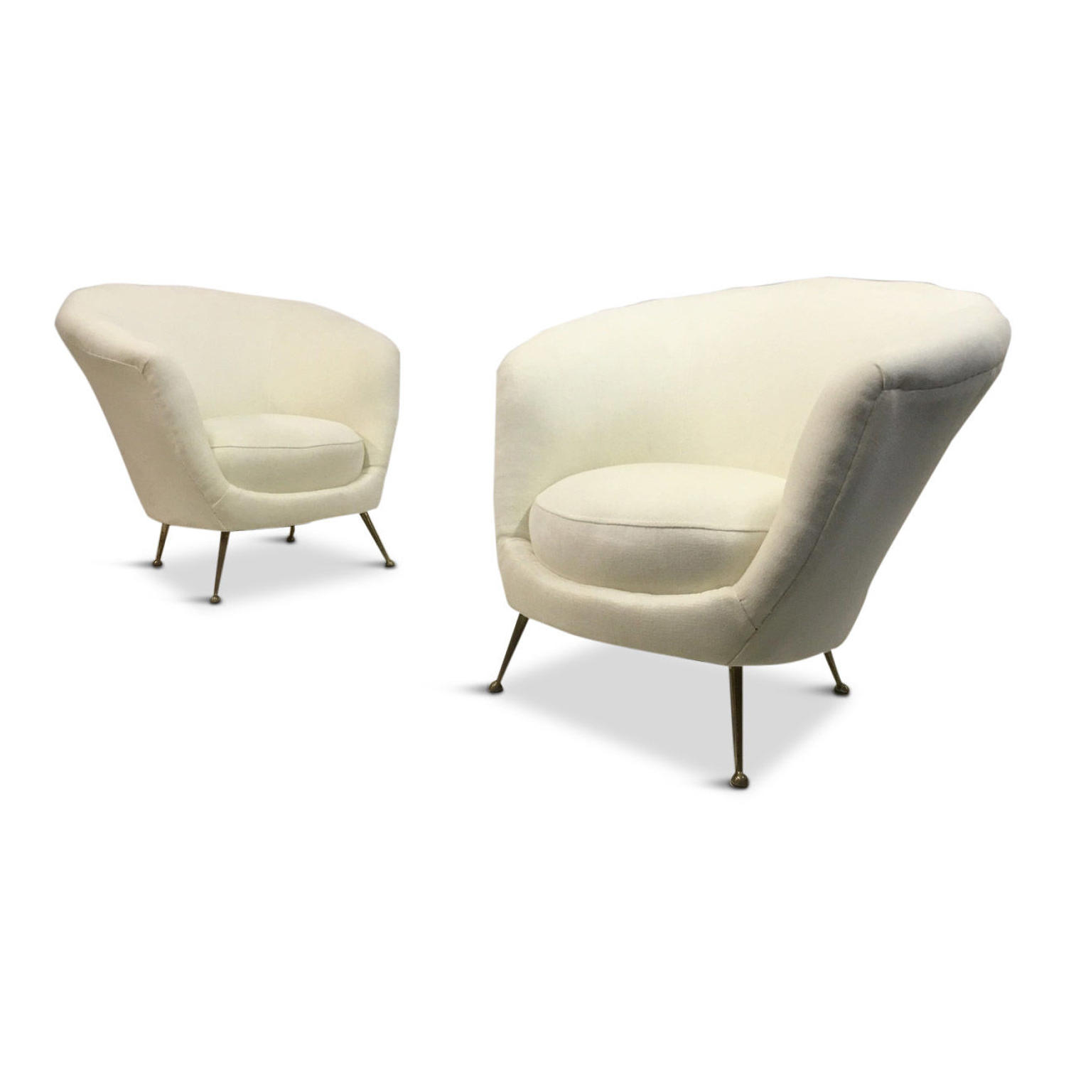 A pair of 1950s Italian armchairs on brass legs