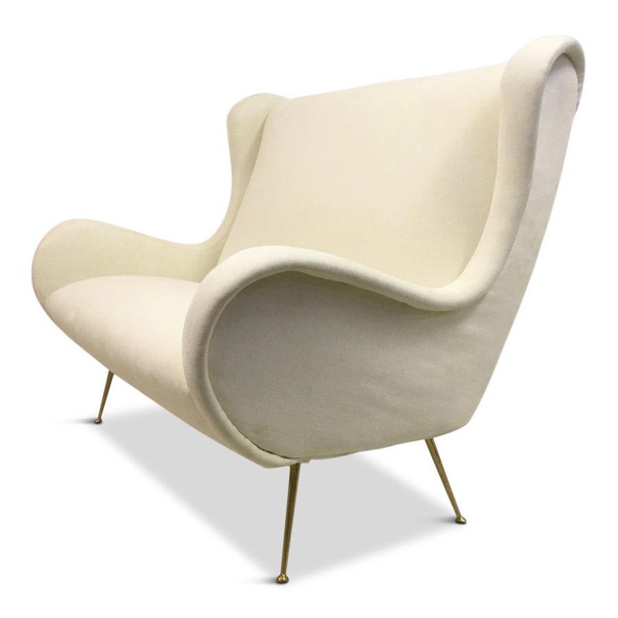 1950s Italian two seater sofa on brass legs