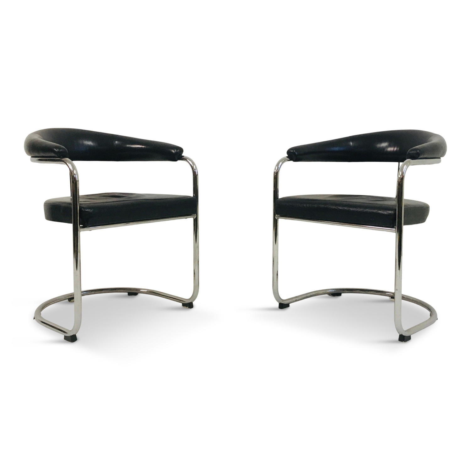 A pair of black leather and tubular steel armchairs for Thonet